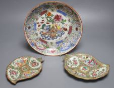A Chinese enamelled porcelain saucer dish, 25cm, and two Canton leaf dishes, 19cm and 18cm