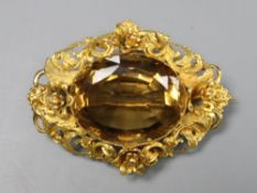 A Victorian pierced yellow metal and citrine set oval brooch, 47mm, gross 12.9 grams.CONDITION: