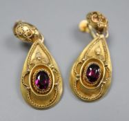 A pair of Victorian yellow metal and garnet set pear shaped drop ear clips, 38mm, gross 5.7 grams.