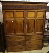 A large late Victorian walnut wardrobe, with fielded panelled doors over six small drawers, width