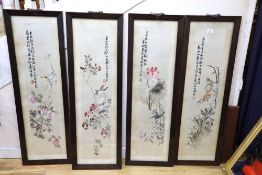 A set of four Chinese embroidered silk pictures worked with birds on flowering branches, each with