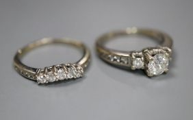 A modern 14k and diamond set engagement ring set, comprising single stone with diamond set shoulders