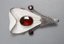 A Scandinavian? parcel gilt white metal, enamel and garnet set stylised leaf brooch, 56mm, gross