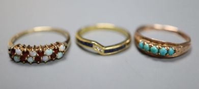 A modern 750 , sapphire and diamond set ring, gross 1.9 grams, and two other gem set rings including