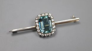 A white and yellow metal, emerald cut aquamarine and white topaz set bar brooch, 6cm, gross 7.2