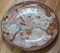 A large Kutani charger, Edo period, diameter 56cmCONDITION: Structurally good; some wear to