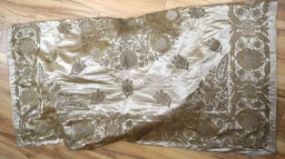 A silk bed cover, heavily embroidered in gold and silver coloured threads, silk lined in pale blue