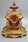 A French rouge marble and ormolu mantel clock, height 46cm