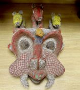 A large Bamileke 'tusked' beadwork mask, Cameroon