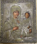 A 18th/19th century Russian painted wood icon with silvered brass oklad, Saint Theotohos