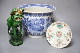 A Chinese blue and white jardiniere, a green glazed lion dog and a famille rose dishCONDITION: Green