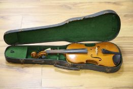 An early 20th century Czechoslovakian 3/4 size violin, bears fake Stradivarius label, cased