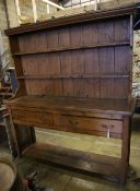 A late 18th century stripped pine dresser, width 182cm depth 50cm height 202cm
