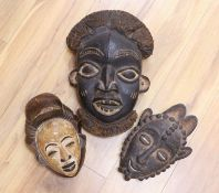 Two Lega tribal wood masks and a Bamileke wood mask (3)