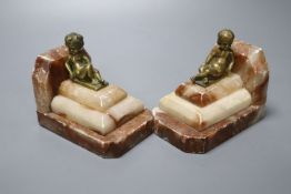 A pair of 1930's stepped marble book-ends, with seated youth surmounts, height 10cmCONDITION: Marble