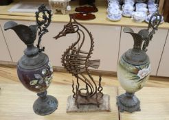 A wrought iron sea horse sculpture, 58cm and two spelter and enamelled glass ewers, 56cmCONDITION: