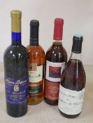 Four bottles: Costieres de Nimes 1997 Pierre Laforest Bergerac 1993 and two others
