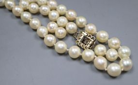 A single strand cultured pearl necklace, with yellow metal and thirteen stone diamond set clasp (
