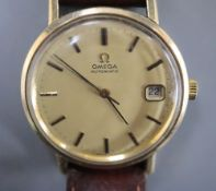 A gentleman's 1970's 9ct gold Omega automatic wrist watch, movement c.1012, movement no. 38167699,