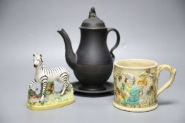 A 19th century Staffordshire pottery model of a zebra, a Victorian relief-moulded frog mug, a