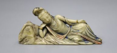 An 18th century Chinese painted soapstone reclining Guanyin, height 12cm