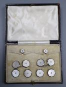 A cased mid 20th century 9ct & 18ct, mother of pearl and seed pearl set eight piece octagonal
