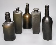 Five antique glass bottles, including two 18th century 'pig snout' gin bottles, two 18th century