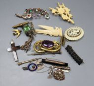 A small group of Victorian and later jewellery including a mourning brooch and silver and enamel dog