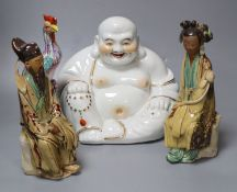 Four Chinese ceramic figures including Budai, 23cm, an enamelled phoenix, 24cm and two Chinese