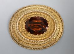 A Victorian yellow metal and citrine set oval brooch, with cannetile work decoration, 41mm, gross