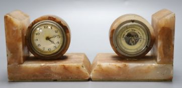 A pair of 1930's marble book-ends, one incorporates an aneroid barometer, the other a timepiece,