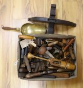 A quantity of assorted hand tools including a bale grabber, a hop poke lifter, brass corn scoops,