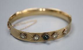 A 9ct and bronze core hinged bangle set with four diamonds and a cabochon stone.