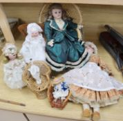 A small collection of bisque head dolls, including a Max Oscar Arnold example, a small German