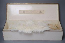 An ostrich feather fan with mother of pearl sticks, in J. Duvelleroy box, Regent Street, fan