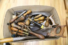 Assorted hand tools including saws, book binding tool etc
