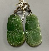 A pair of white and yellow metal, diamond chip set carved jade drop earrings, jade 35mm, gross 14.