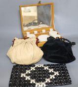 A 1960's plastic black and cream clutch bag, a black velvet bag and cream bag with Bakelite frame