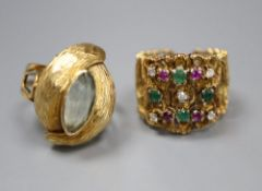 A textured 14k, emerald, ruby and diamond dress ring, size K/L, gross 9.2 grams and a continental