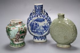 A Chinese blue and white moon flask, a Chinese celadon glazed moon flask and a famille verte