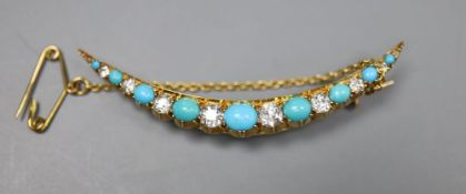 An Edwardian yellow metal, graduated turquoise and diamond set crescent brooch, 52mm, gross 5.3