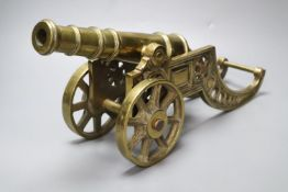 A large brass signal cannon on elaborate carriage, length 42cm