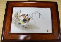 A 20th century Chinese porcelain plaque painted with birds, flowers and bamboo bearing partial