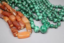 Nine assorted single strand malachite bead necklaces, one with gilt metal spacers and two agate