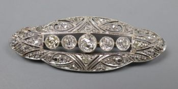 A 1920's pierced white metal and diamond set shaped oval brooch, 42mm, gross 5.8 grams.CONDITION: