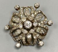 A Victorian pierced yellow and white metal, graduated diamond set circular brooch, 36mm, gross 12.