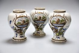 A set of three 19th century Dutch delft baluster jars, painted in colours, 14cmCONDITION: One jar