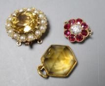 A yellow metal, ruby and diamond set flower head clasp, 12mm, a citrine and seed pearl set clasp and