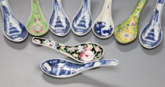 Six Chinese blue and white rice spoons, a famille rose spoon and a Canton enamel spoonCONDITION: All