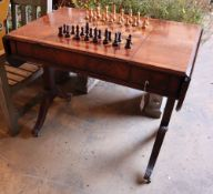 A George III style walnut sofa / games table with sliding reversible top, includes chess and
